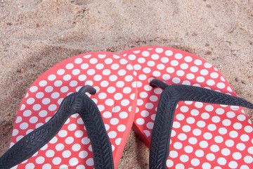 modern dotted thongs in the sand on the beach