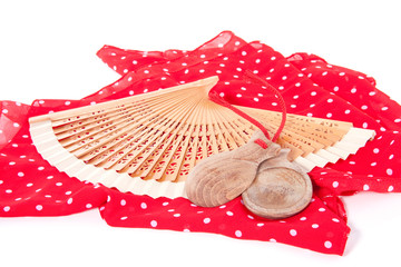 a spanish flamenco fan with wooden  castanets  isolated over whi