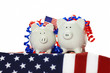 Two Patriotic Piggy Banks on American flag