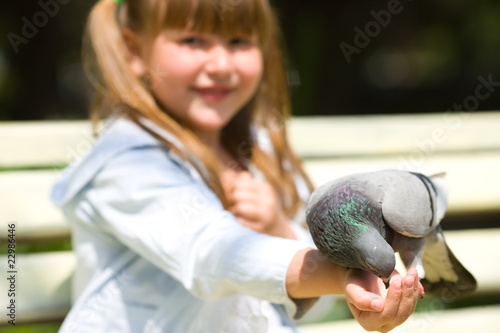 Girl Feeding Pigeon