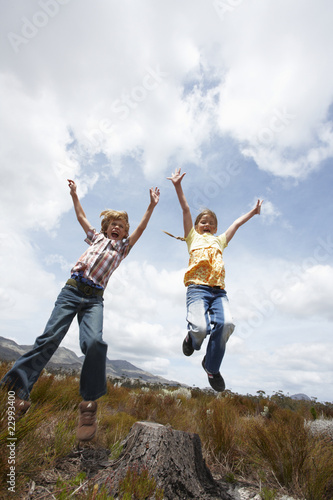 Kids jumping in the fields