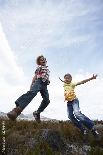 Two kids jumping