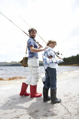 Father and son fishing at a lake