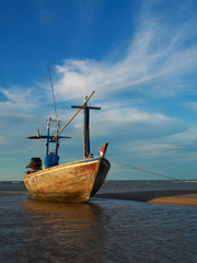 fishing boat in blue sky