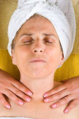 Aged woman getting neck massage