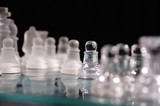 Opaque and clear chess set. poster