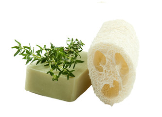 Natural lufah sponge wlth thyme aromatic soap, isolated