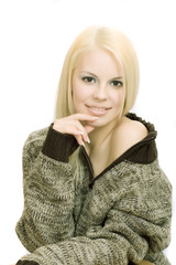 Young blonde woman in sweater with make-up on white background