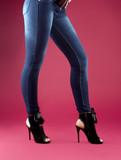 Legs slender girl in black sandals poster