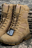 Fototapety desert tactical boots and military tag chains