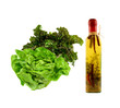 green salad with bootle of spiced olive oil
