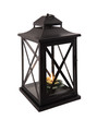 black iron lantern with lit candle