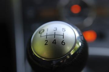 closeup of gear change stick with six speeds