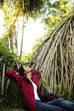 ecotourism: woman  relaxing in the rainforest poster