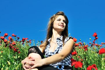 happy girl in poppy field