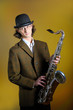 young man  in bowler hat holding saxophone