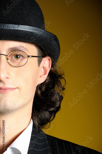 Close up portrait of young man in bowler hat