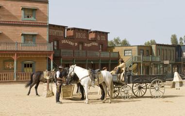 Cowboys watering horses