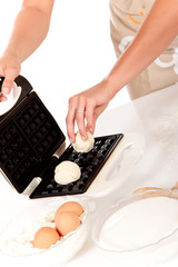 Woman baking Belgium waffles