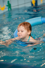 little child in swimming pool