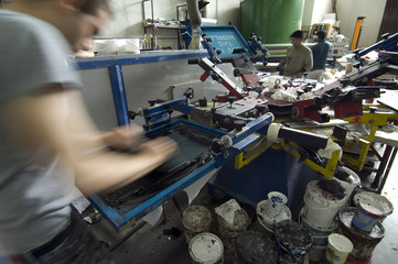 man at work in serigraphy
