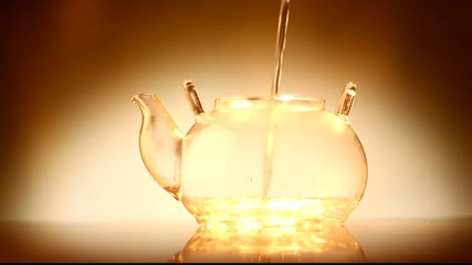 Pouring water in teapot