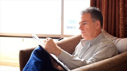 Man Finishing Writing Notes