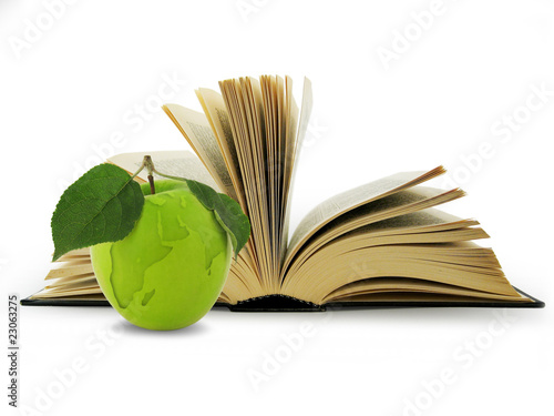 Open Book and globe in green apple. Concept education