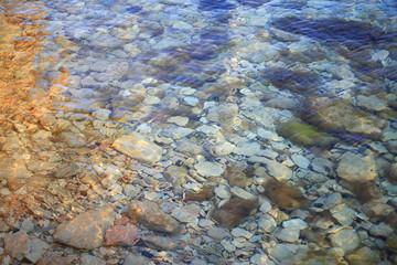 Stones under sea water background