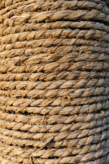 old manila rope wrapped neat and tight around pole