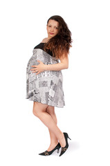 pregnant young woman in everyday clothing