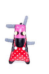 a collorful handmade sewn doll isolated over white