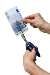 hands cutting one banknote with scissors