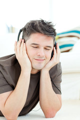 Smiling man listening the music