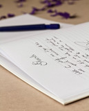 Opened wedding guest book with a pen poster