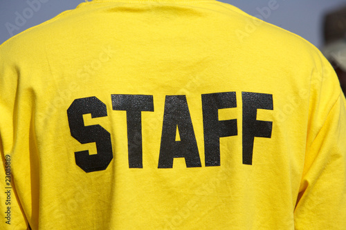staff person with bright yellow shirt