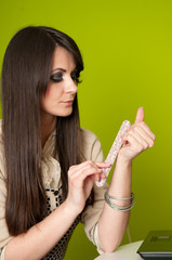 Businesswoman filing nails