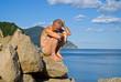 Man on rocks at sea 13