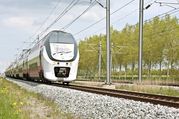 Train running in the countryside from the Netherlands