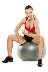A female working out with a dumb bell isolated on white