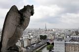 Gargoyle Statue Against Overcast Sky poster