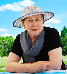 Happy senior woman outdoors in summer