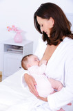 Woman breastfeeding baby poster