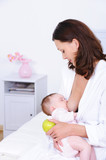 Woman breastfeeding her baby and holding apple poster