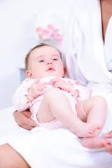 Newborn baby in mother's hands