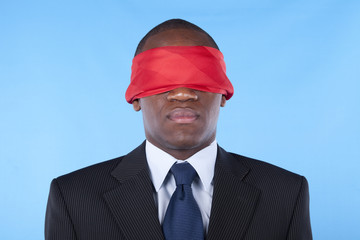 blindfold african businessman