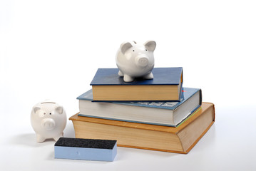 piggy bank on note books