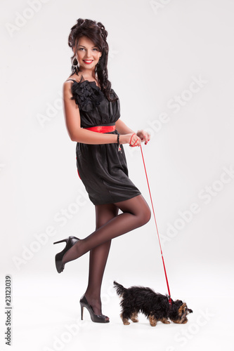Young Woman With A Little Dog