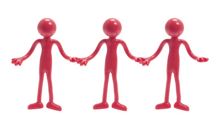 Miniature Figures Holding Hands