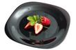 Fresh ripe strawberry on black dish